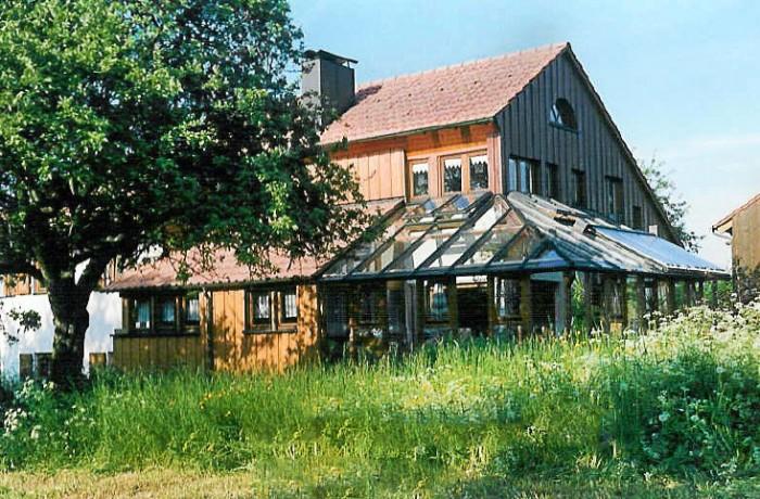 Holzhaus mit Wintergarten